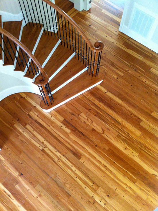 Custom Stained Reclaimed Heart Pine Flooring & Staircase - 6 inch reclaimed heart pine flooring from 150 year old beams. Finished with custom mixed stain and Bona Traffic HD satin by Green Step Flooring, Inc. Home is located in Governors Club, Chapel Hill, NC
