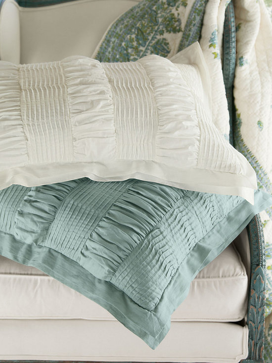 Sonora Bed Sham - Divinely sculptural, our Sonora collection is a study in pure, tactile perfection. Fashioned of sublimely soft cotton voile, it's masterfully sewn in alternating bands of pintuck pleats and elaborate ruching for a dramatic swagged look. The result? A swoon-worthy layer for the bed - as lofty and light as a cloud. Generous poly fill enhances the sumptuous texture and creates the perfect weight for a restful night. Matching sham features a double flange and mother-of-pearl button back closures.