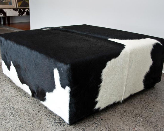 Gorgeous Creatures New Zealand - Square ottoman in black and white cowhide - A large square black and white cowhide ottoman 98cm x 98cm x 40cm tall with low wood feet. This gorgeous ottoman needed a very big cowhide rug to make it because it was so large.