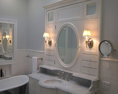 White built in vanity and marble sink traditional bathroom