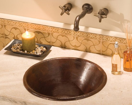 Cazo Antique Copper Sink by Native Trails - Cazo copper sink from Native Trails is a distinct and versatile self-rimmed sink. Dropped in over the counter, Cazo's rolled rim and deep narrowing bowl subtly draw attention to the hand-hammered finish. Or flaunt Cazo's details as a vessel sink, and create a clean yet dramatic effect. Either mount choice provides a deep, unique bowl, beautiful in three finishes; Natural, Antique, and hand-dipped Brushed Nickel.