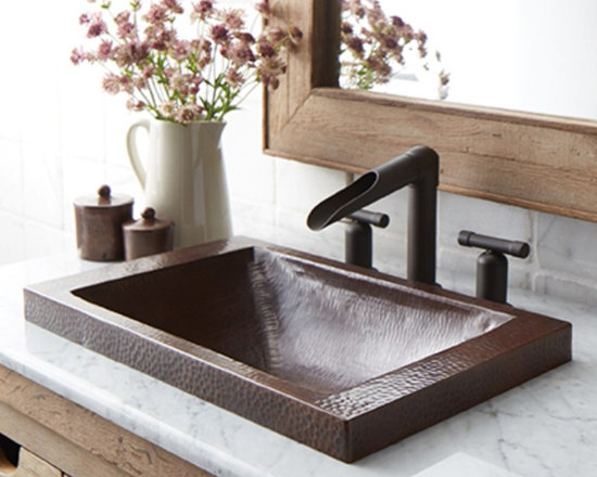 Hana Copper Bath Sink in Antique - Want visual impact and versatile design? Look no further. With its defining texture and unique sloped bowl, Hana is both beautiful and uncomplicated. As a copper drop-in sink, Hana provides for easy installation; a raised profile shows off more of the gorgeous hand hammered copper. Hana copper bathroom sink is artisan crafted; forged of high-quality recycled copper. Copper has been used for centuries in kitchens and baths throughout the world. Hana brings modern functionality to a classic material.