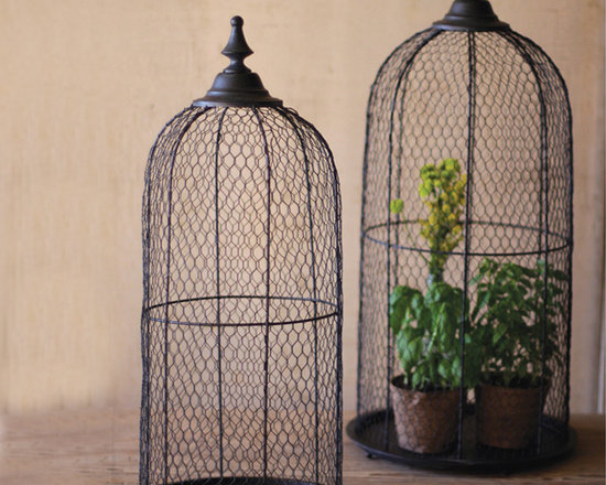 """Wire Bird Cage Domes (Set of 2) - While we would not suggest that you actually place live birds in these, we have to admit that the cage shape calls for something that just sings! Tray on the bottom, finial on the top, plenty of room to capture a plant or two in the center. Set of two. These unique, hand-crafted accessories are imported from small cottage industries in Colombia, Honduras, Haiti, Morocco, and more. Dimensions: 13""""dia x 22""""h"""