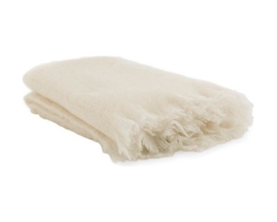 Design Within Reach - Mohair Blanket, Cream - Wrap yourself in this luxuriously soft Mohair Blanket and you'll understand why mohair, which is made from the hair of the Angora goat, has been prized since the 1500s. As warm as a hug, the high-quality mohair fibers are naturally durable and breathable. Mohair's inherent strength and flexibility have led to its use in a wide range of applications since Angora goats were brought to the West in the mid-1800s – from blankets and scarves to train seats and cowboy's chaps. Our 100% brushed Mohair Blanket was woven at a mill in County Wicklow, Ireland, which has been manufacturing tweeds and blankets since 1723. These blankets are great for throwing over the bed, a sofa or yourself. Made in Ireland.