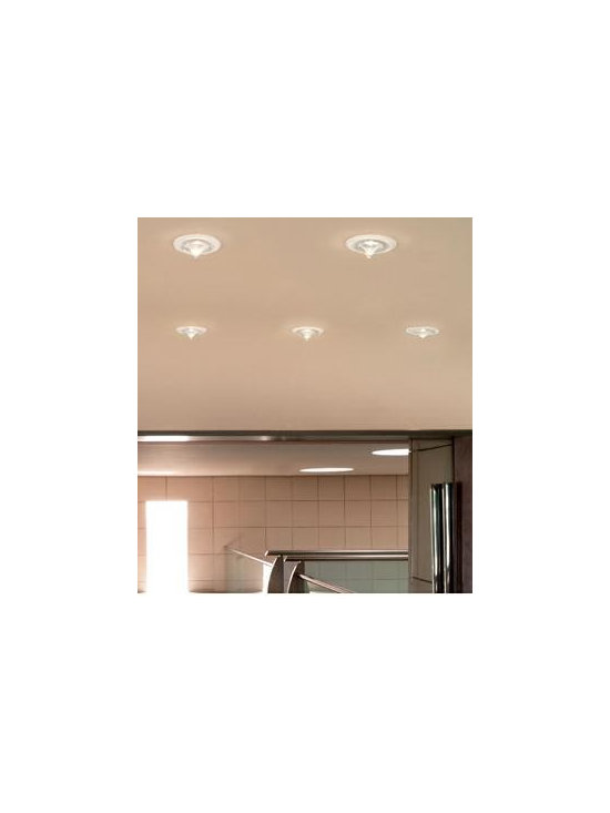 Drop Ceiling Lamp By Leucos Lighting - Leucos recessed fixtures Drop is a semi-recessed, low-voltage fixture providing downward light through a poured glass diffuser available in crystal or satin white glass with a clear tip.