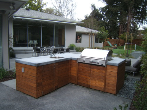 Love the wood cabinets for the outdoor kitchen. Where can I get them? What type of wood are they ...