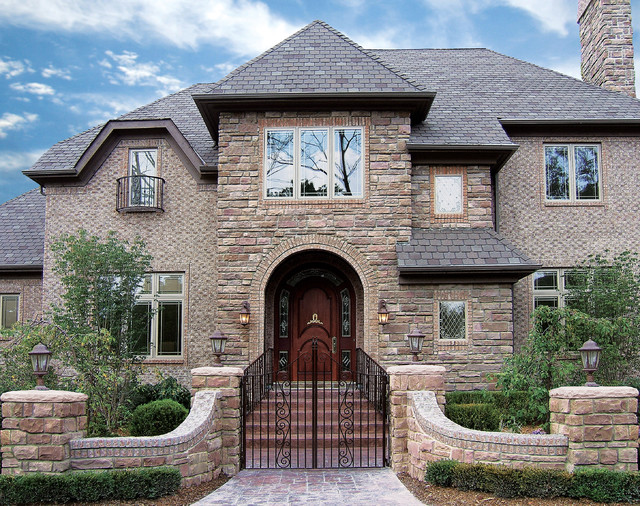 Majestic colonial house coronado manufactured stone veneer traditional exterior - Houses with stone veneer facades ...
