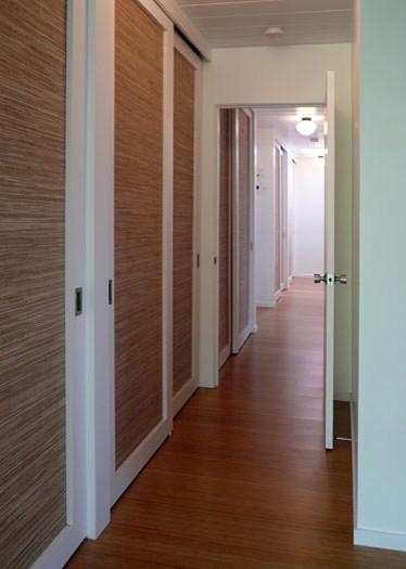 Klopf architecture - hallway with lights on midcentury-hall