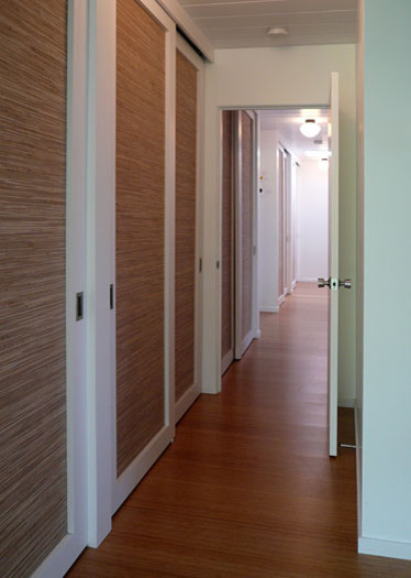 Klopf architecture - hallway with lights on modern hall