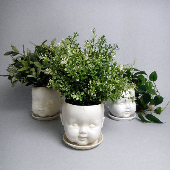 Porcelain baby doll head planter eclectic-vases