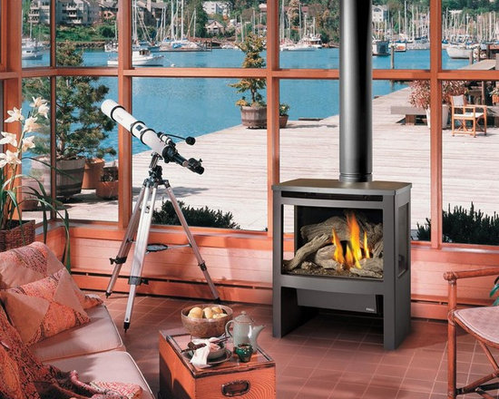 Avalon by Travis Industries - Avalon Cypress GreenSmart Gas Stove - Includes Dancing-Fyre Burner, Comfort Control Feature, and interior Accent Light. Choice of interior media includes Classic Log set, Driftwood Fire Art, and Fyre-Stones Rock set.  Optional 160 CFM Fan & GreenSmart Remote Control.