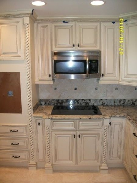 Off white with glaze traditional kitchen cabinetry for Kitchen cabinets 75 off
