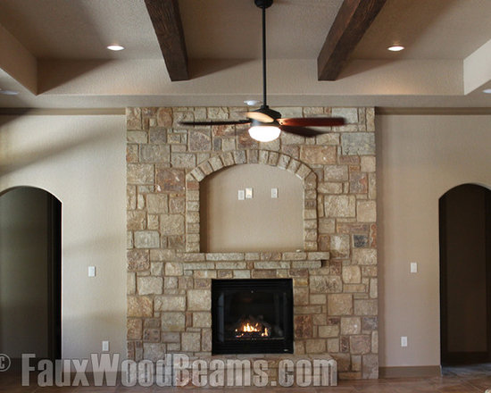 Sandblasted Faux Beams - Use faux wood beams to add movement to your ceiling design plans and highlight other focal points of the room such as fireplaces.
