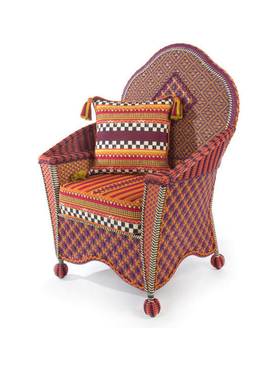 Sunset Outdoor Wing Chair | MacKenzie-Childs - Exotic yet familiar, the Sunset Outdoor Collection can instantly turn any terrace or porch into a luxurious retreat. Rich golds, oranges, purples, and blues, with flashes of magenta, recall blazing summer sunsets over Cayuga Lake. Hand-woven resin wicker is as durable and comfortable as it is striking. Cushions feature a printed pastiche of patterns, quintessentially MacKenzie-Childs: checks, squiggles and dots, scallops and leaves, and bold stripes.