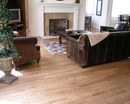"Private Residences - 2-1/4"" Strip Red Oak solid hardwood flooring, stained in custom color, site sealed with Synteco 35 Satin finish."