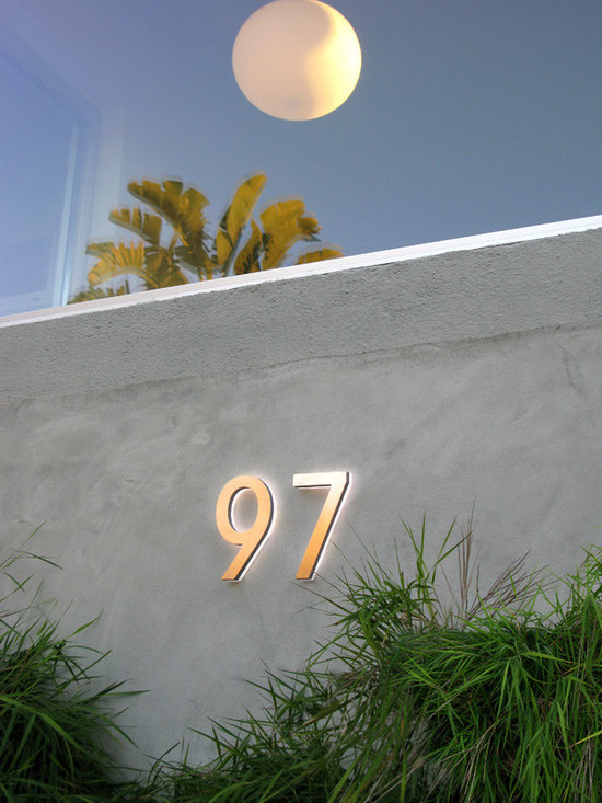 """Modern LED House Numbers & Apartment Aluminium Numbers - These are modern Illuminated Architectural LED House Numbers suitable for wet outdoor locations. The standard size is 5"""" inches made from solid aluminum cast with a solid acrylic back panel that houses the CREE or OSRAM LED chips. We offer custom size and design solutions for contract projects."""
