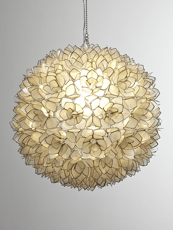 Lighting - Exclusively ours. Translucent capiz shells are fashioned into flowers and edged with silvery metal to form this breathtaking sphere. To display two as shown above the table, we cut the cords to the desired length and hardwired the pendants.