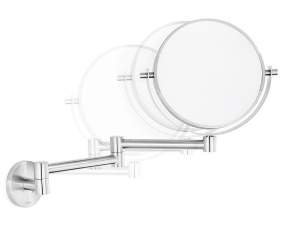 Blomus - Primo Wall Mounted Cosmetic Mirror - Ready for your closeup? This cosmetic mirror will allow you to perfect your starring appearance of the day. It swivels to meet you, to help utilize the light while avoiding the glare.