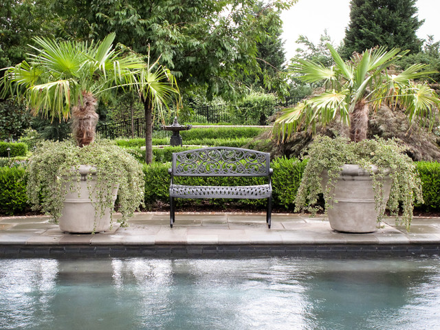 Pool with Planters and Bench traditional-landscape