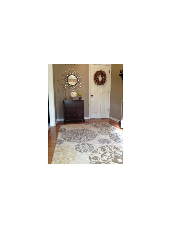 Mohawk Home Cream Medallion Area Rug - Warm up any living space with the Mohawk Home Medallion Area Rug. Machine weaving and 100% Olefin materials make this throw rug as durable as it is fashionable. The Mohawk rug's neutral cream color and classic 5' x 7' size inject a shot of understated style to any indoor area. Soap and water cleanup is a breeze.