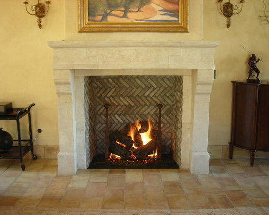 Custom Items - One of our many gas log sets accented with iron nail head style andirons.