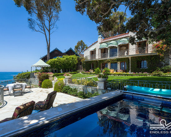 Original Endless Pools® - The versatile Endless Pool is at-home in simple basement installations, garage renovations, suburban backyards, and even in grand Italianate villas like this Laguna Beach property. It's strategically positioned with ocean and garden views and under a shade tree.