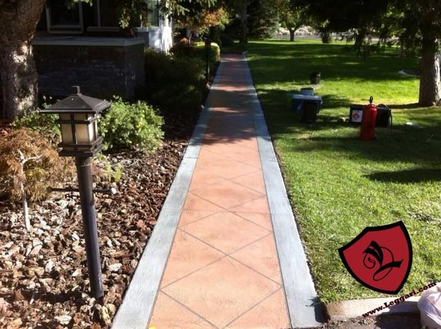 Leggari concrete renovation involving removal of brick and mastic off existing c