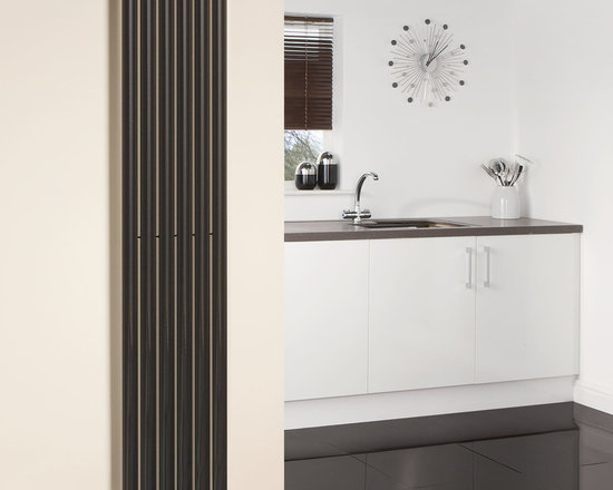 Hudson Reed - Hudson Reed Revive High Gloss Black Vertical Designer Radiator 70 x 14 - Hudson Reed - Revive High Gloss Black Vertical Designer Radiator 70 x 14  With a heat output of 1,120 Watts (3,823 BTUs), this vertical designer radiator, in a fashionable high gloss black finish (RAL9005), is stylish and highly efficient, ensuring that your room is heated quickly.  This luxury radiator is designed especially for use in any room, looking equally stylish in a modern or traditional setting; its six high gloss black vertical tubes bring a touch of elegance to any living space. This modern minimalist radiator is also highly functional, connecting directly into your domestic central heating system via the angled radiator valves included. This radiator comes complete with a 10 YEAR GUARANTEE.  High Gloss Black Vertical Designer Radiator 70 x 14 Details:  Dimensions: (H x W x D) 70 (1780mm) x 14 (354mm) x 2.25 (57mm) Output: 1,120 Watts (3,823 BTUs)  Pipe centres with valves: 16.95 (430m) Wall to centre of tapping: 2.5 (65mm) Number of vertical tubes: 6 (1 thickness) (25mm) Fixing Pack Included (see image above) Designed to be plumbed into your central heating system Suitable for bathroom, cloakroom, kitchen etc. Please note: angled radiator valves included  Please Note: Our radiators are designed for forced circulation closed loop systems only. They are not compatible with open loop, gravity hot water or steam systems.