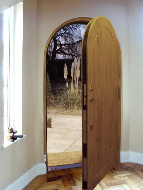 Arched armored door - Farmhouse - Front Doors - london ...