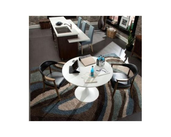 Ink Swirl by Mohawk Home - The Mohawk Ink Swirl Cocoa 5 ft. x 8 ft. Area Rug features a bold, striking look in a simple, freeflowing design consisting of blues, browns and tans. The rug's shag weave offers softness and comfort in a contemporary look that adds beauty to variety of decor styles. The rug is resistant to stains and fading.