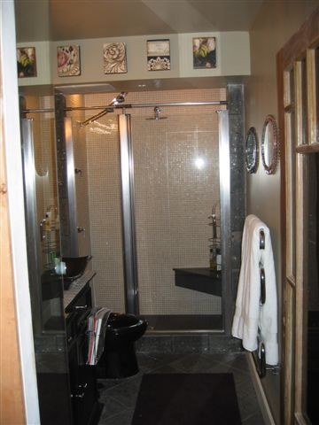 Shower for 2 replaces tub for no one. traditional bathroom