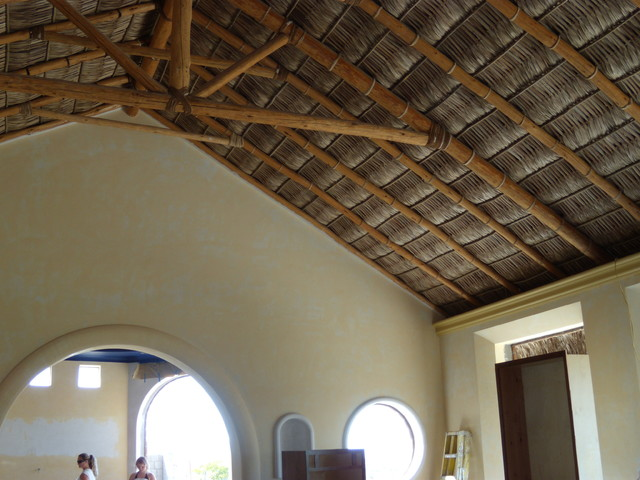 Mexican Hacienda with palapa roof mediterranean-living-room