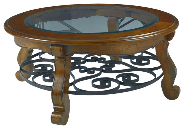 Hammary siena glass top round cocktail table with iron for Traditional glass top coffee table