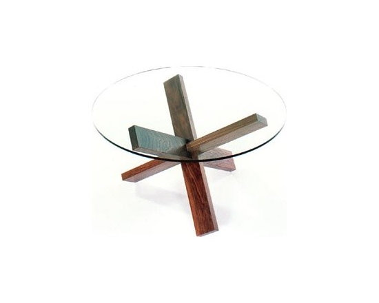 Think Puzzle Table - Inspired by the joinery of a traditional Japanese three-dimensional puzzle, the solid wood legs of this intriguing glass-topped coffee table slide together smoothly and lock firmly in place without mechanical fasteners.