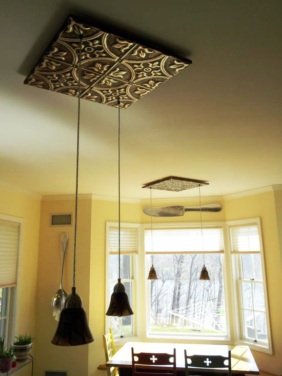 Tin Tile Light Fixtures - Tin ceiling tiles used as an interesting way to hang lighting. Pattern 2 Oil Rubbed Gold tin ceiling panel.
