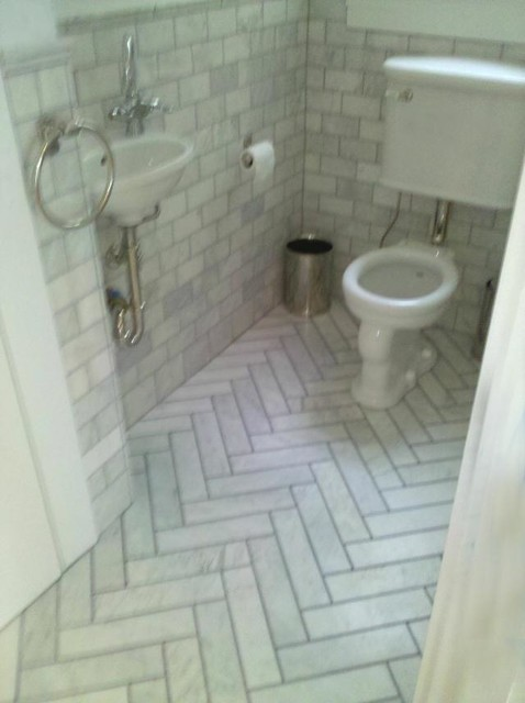 Beautiful Carrera Marble Subway Tile Walls And Herringbone Tile Floors