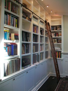 Built-in Bookcases With Rolling Library Ladder