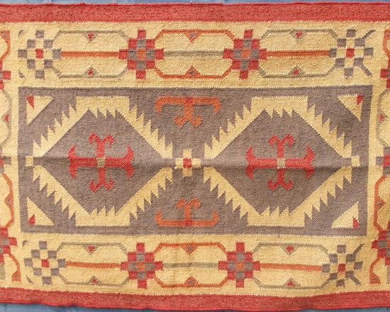 Dhurrie rugs - Called Dhurries in India and Kilims in the middle east, all our rugs are hand woven in both contemporary and classic designs on looms in a factory in a small village in Rajasthan, India. They are made from wool and jute which makes them extra durable and hard wearing. They are colour-fast so can be cleaned with soapy water on small areas, and easily brushed or vacuumed. All our workers are paid a fair price and work in a clean airy environment, with the men being the weavers and the women dyeing the wool and jute, using mainly natural dyes, as they have done for centuries.
