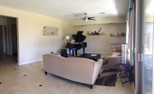 Living room with a baby grand piano for How to place a piano in a room