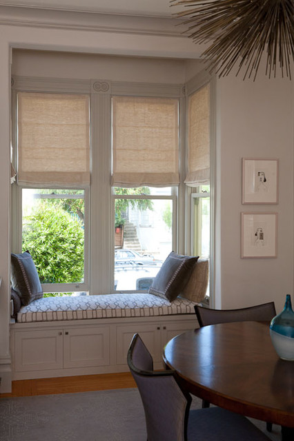 Motorized Roman Shades In A Bay Window And Built In Window