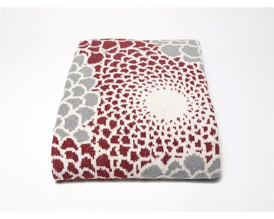 Eco Zinnia Throw-Pomegranate/Smoke - This stunning throw blanket in Pomegranate/Smoke features a floral motif that is anything but dainty and sweet. Instead, this throw is graphic, bold, and beyond gorgeous. Use this blanket to liven up any space.