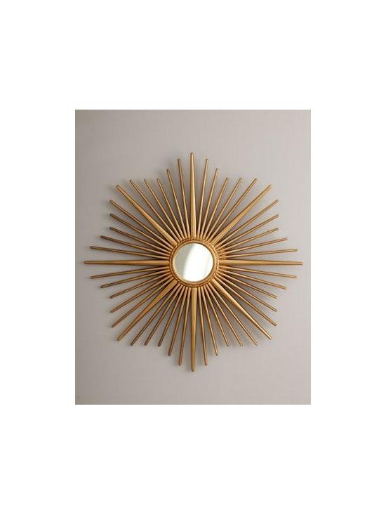 Golden Sunburst Mirror - A small round mirror resides inside the brilliant rays of this sunburst-framed mirror.