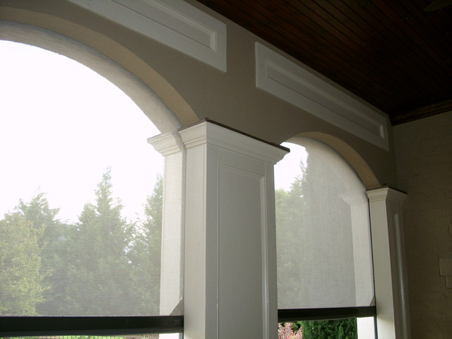 Arched openings with stucco surface