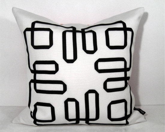 Black and White Mazing Outdoor Decor Cushion - This bold pillow features decorative trimming in a black modern greek key inspired design so popular in Interior design. Crafted in white and black Sunbrella outdoor canvas for the boat, patio, pool side or any stylish space - indoors or out! Fully finished inside with a reinforced, weather proof zippered closure. Cover or bring indoors when not in use for longevity.