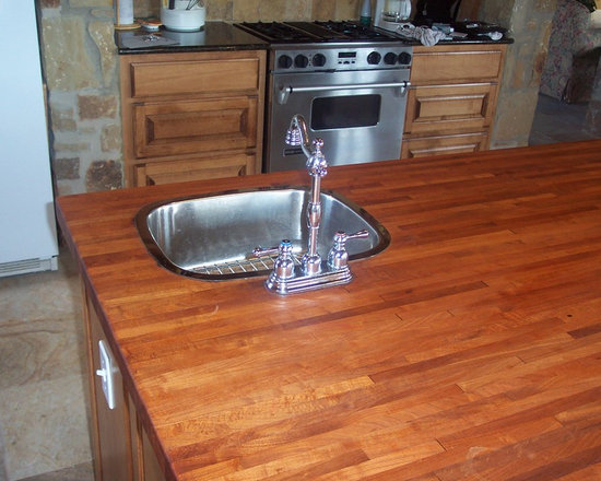 WR Woodworking - Mesquite Edge grain wood counter tops - Mesquite, edge grain center island with vegetable sink.  wrwoodworking.com
