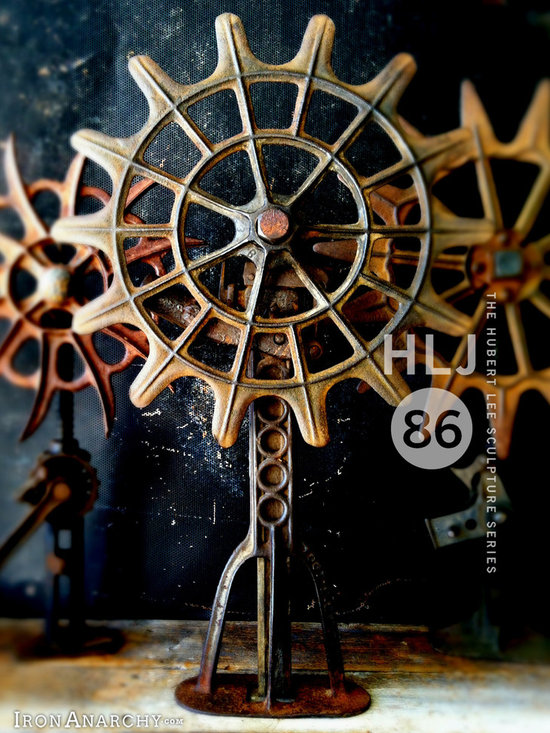 """Antique Industrial Gear Decor - Ornate 1800's cast iron wheel mounted on an antique buggy jack pedestal. Wheel spins. One-of-a-kind. Jacks up from 25""""-35"""" tall."""