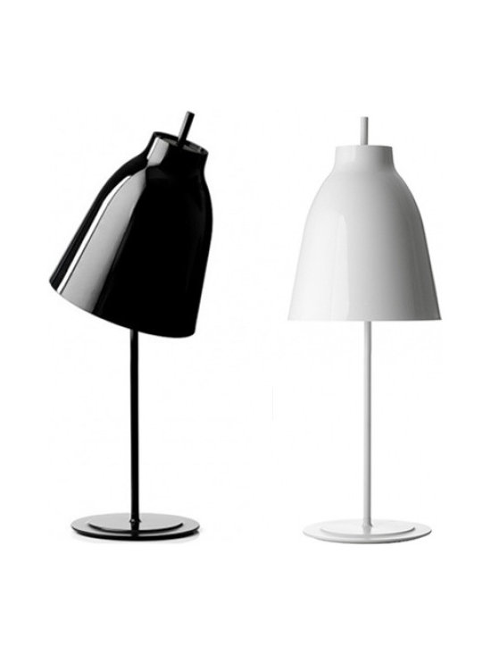 Caravaggio TableLamp by Cecilie Manz - CECILIE MANZ graduated from the design school Danmarks Designskole in Copenhagen in 1997 with additional studies at the University of Art and Design in Helsinki; Cecilie Manz founded her own design studio in Copenhagen in 1998. Here, Cecilie Manz has established herself as one of the most prominent designers from Denmark. Her work within furniture, glass, lighting and ceramics has achieved international success and is sold and exhibited all over the world.