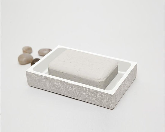 "Manchester Soap Dish-Sand - Up your elegance and add an edge to your aesthetic with our striking faux shagreen Manchester collection. Each piece is crafted to highlight the natural ""eye"" pattern inspired by real shagreen, and topped with a wood veneer trim. Available in five colors, every set is hand-finished to bring out the highs and lows of each hue. Turn the page to see the Manchester in every color!"