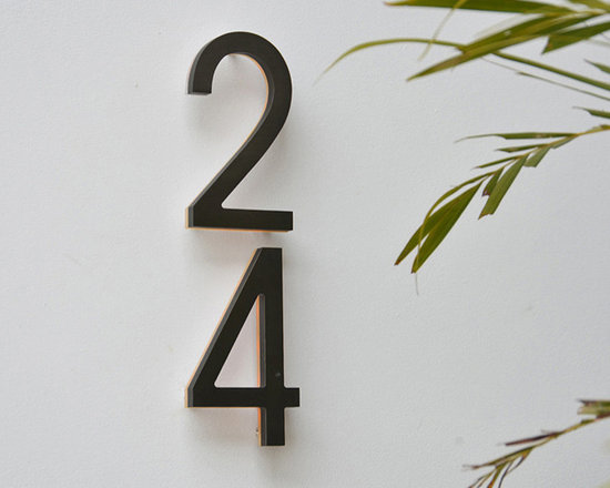 """Bronze LED Backlit House Numbers 5"""" Outdoor by Luxello - Modern Bronze Back lit Illuminated House Numbers are available in a 5 and 8 inch size. The modern 5"""" outdoor numbers are finished is an anodized oil rubbed bronze color with an illuminated white or amber edge. These bronze LED House number are IP 44 rated and suitable for residential and commercial sign applications."""