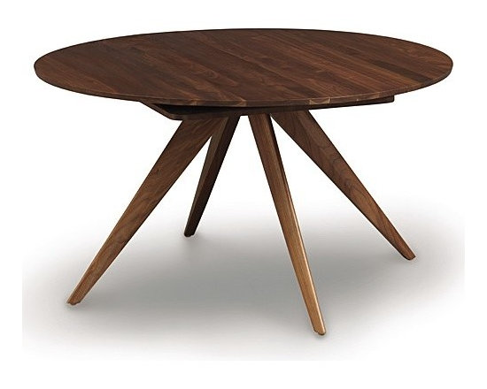 "Copeland Furniture - Catalina Round Extension Table, 60 Inches | Copeland Furniture - Hand-crafted in Vermont by Copeland Furniture.Create an intimate dinner setting with the Catalina Round Extension Table, 60 Inches. Constructed from solid cherry or walnut hardwood, the tapered legs of this dining table radiate out from a central point for a dynamic look. Easily expand the table into an oval shape to accommodate more guests using the self-storing butterfly leaf. The butterfly leaf stores directly inside the table and can easily be opened or closed by a single person. Bring mid-century modern style to the dining room with the Catalina Round Extension Table, 60 Inches. Copeland Furniture uses sustainably harvested hardwoods from the American Northern Forest. All lumber used by Copeland Furniture comes from within 500 miles of their factory in Vermont, thus reducing fossil fuel consumption and carbon dioxide emissions from transportation. The environmental values of preservation and stewardship are reflected in every piece of furniture produced by Copeland Furniture.  Product Features:  Self equalizing, ball bearing extension glides Single 24"" wide self-storing butterfly leaf Single handed operation Expands to 84"" wide Finished with a low sheen top coat Eco-friendly Hand-crafted in the U.S.A."